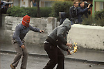 Northern Ireland Catholic youths rioting throwing petrol bombs. Probably taken in Etna Drive, Ardoyne north Belfast.