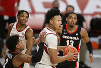Arkansas forward Jaylin Williams (10) rebounds, Saturday, January 9, 2021 during the second half of a basketball game at Bud Walton Arena in Fayetteville. Check out nwaonline.com/210110Daily/ for today's photo gallery. <br /> (NWA Democrat-Gazette/Charlie Kaijo)