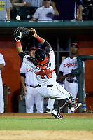 Lansing Lugnuts catcher Andres Sotillo (16) tries to catch a pop fly during the game against the South Bend Cubs at Cooley Law School Stadium on June 15, 2018 in Lansing, Michigan. The Lugnuts defeated the Cubs 6-4.  (Brian Westerholt/Four Seam Images)