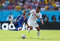 Antonio Candreva of Italy is tackled by Michael Umana of Costa Rica