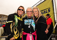 Jul. 31, 2011; Sonoma, CA, USA; NHRA top fuel dragster legend Shirley Muldowney (center) poses for a picture with pro stock motorcycle riders Karen Stoffer (left) and Angie Smith during the Fram Autolite Nationals at Infineon Raceway. Mandatory Credit: Mark J. Rebilas-