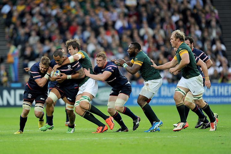 07 October 2015: Samu Manoa of USA drives forward despite the efforts of Eben Etzebeth of South Africa during Match 31 of the Rugby World Cup 2015 between South Africa and USA - Queen Elizabeth Olympic Park, London, England (Photo by Rob Munro/CSM)