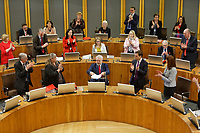 Pictured: Assdembly Members applaud First Minister for Wales Carwyn Jones (C). Tuesday 11 December 2018<br /> Re: First Minister for Wales Carwyn Jones during his last First Minister Questions at the Senedd in Cardiff Bay, Wales, UK. He will be succeeded by Assembly Member Mark Drakeford.