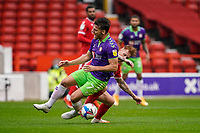 3rd October 2020; City Ground, Nottinghamshire, Midlands, England; English Football League Championship Football, Nottingham Forest versus Bristol City; Chris Martin of Bristol City is tackled hard by Jack Colback of Nottingham Forest