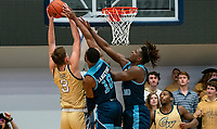 WASHINGTON, DC - FEBRUARY 8: Cyril Langevine #10 and Jermaine Harris #0 of Rhode Island go up to block a shot by Chase Paar #3 of George Washington during a game between Rhode Island and George Washington at Charles E Smith Center on February 8, 2020 in Washington, DC.