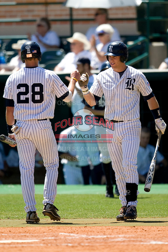 Rice Owls second baseman Michael Ratterree #8 congratulates teammate Geoff Perrott #28 after he scores against the Memphis TIgers in NCAA Conference USA baseball on May 14, 2011 at Reckling Park in Houston, Texas. (Photo by Andrew Woolley / Four Seam Images)