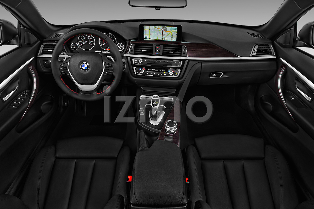 Stock photo of straight dashboard view of 2017 BMW 4-Series 430i 2 Door Convertible Dashboard