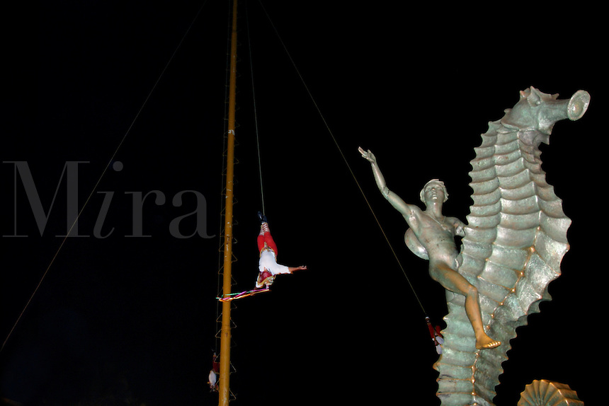 Puerto Vallareta. On the Malacon Papantla Flyers (Voladores de Papantla) pre-Columbian religious ritual with the Boy and Seahorse.
