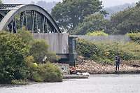 BNPS.co.uk (01202) 558833. <br /> Pic: BNPS<br /> <br /> Pictured: Emergency services search for 18-year-old Callum Osborne-Ward the day after the teenager was swept away. <br /> <br /> A grieving mother who complained to a caravan park about the lack of safety measures at a beach where her son drowned has been offered a free holiday in response.<br /> <br /> Callum Osborne-Ward, 18, was swept away in front of his family moments after rescuing several children from a deadly riptide at Rockley Point in Poole Harbour, Dorset, last month.<br /> <br /> His devastated mother Ann Marie Osborne has since criticised holiday firm Haven, which owns the caravan park backing onto the waterway, for failing to warn visitors about the hidden riptide and advertising the beach on its website.