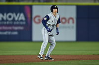 Brady McConnell (13) of the Columbia Fireflies takes his lead off of second base against the Kannapolis Cannon Ballers at Atrium Health Ballpark on May 18, 2021 in Kannapolis, North Carolina. (Brian Westerholt/Four Seam Images)