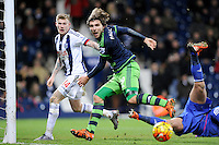 Alberto Paloschi of Swansea City is denied by Goalkeeper Ben Foster of West Bromwich Albion and the post during the Barclays Premier League match between West Bromwich Albion and Swansea City at The Hawthorns on the 2nd of February 2016