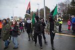 © Joel Goodman - 07973 332324 . 26/01/2014 . Salford , UK . Approximately 500 protesters march to an iGas fracking exploration site at Barton Moss , Salford , today (Sunday 26th January 2014) . They walk along the A57 road , blocking traffic as they do . A long term protest camp has been established on an access road leading to the site and today (26th January) protesters from other areas of the country travelled to the site to join with other protesters against fracking . Photo credit : Joel Goodman