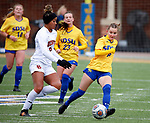BROOKINGS, SD - MARCH 14: Avery LeBlanc #8 from South Dakota State controls the ball against Jordan Crockett #6 from Denver during their match at Dana J. Dykhouse Stadium on March 14, 2021 in Brookings, South Dakota. (Photo by Dave Eggen/Inertia)