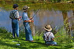 Like a Norman Rockwell painting, three Amish boys spend an idyllic afternoon fishing in Lancaster County, Pennsylvania.