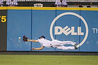 Round Rock Express outfielder Jared Hoying (30) dives for a ball in the outfield during the Pacific Coast League baseball game against the Oklahoma City RedHawks on August 1, 2014 at the Dell Diamond in Round Rock, Texas. The Express defeated the RedHawks 6-5. (Andrew Woolley/Four Seam Images)