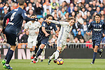 Luka Modric (r) of Real Madrid fights for the ball with Jose Luis Garcia del Pozo, Recio, of Malaga CF during their La Liga 2016-17 match between Real Madrid and Malaga CF at the Estadio Santiago Bernabéu on 21 January 2017 in Madrid, Spain. Photo by Diego Gonzalez Souto / Power Sport Images