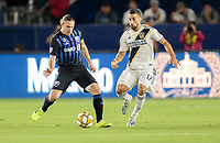 Samuel Piette #6 of Montreal Impact and Sebastian Lletget #17 of the Los Angeles Galaxy chase after a ball