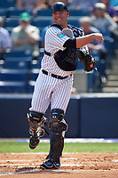 New York Yankees catcher Brian McCann (34) throw down to third base during a Spring Training game against the Detroit Tigers on March 2, 2016 at George M. Steinbrenner Field in Tampa, Florida.  New York defeated Detroit 10-9.  (Mike Janes/Four Seam Images)