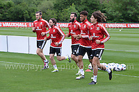 Some of the Welsh players warm. Including Joe Ledley (centre) who is going to the Euro finals and still recovering from an injury during the Wales Open Training Session on Wednesday 1st June 2016 at the Vale Resort, in the Vale of Glamorgan. <br /> <br /> <br /> Jeff Thomas Photography -  www.jaypics.photoshelter.com - <br /> e-mail swansea1001@hotmail.co.uk -<br /> Mob: 07837 386244 -