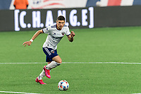 FOXBOROUGH, MA - APRIL 24: Joseph Mora #28 of D.C. United brings the ball forward during a game between D.C. United and New England Revolution at Gillette Stadium on April 24, 2021 in Foxborough, Massachusetts.