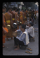 Monks gathering alms in early morning