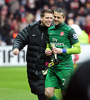 Pictured: Arsenal goalkeeper Lukasz Fabianski (in green) with team mate is laughing off a verbal argument he had with Michu of Swansea (not pictured).  Saturday 16 March 2013<br /> Re: Barclay's Premier League, Swansea City FC v Arsenal at the Liberty Stadium, south Wales.