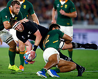 Damian de Allende of South Africa tackling Kieran Read (c) of New Zealand (All Blacks) during the Rugby World Cup Pool B match between the New Zealand All Blacks and South Africa Springboks at the International Stadium in Yokohama, Japan on Saturday, 21 September, 2019. Photo: Steve Haag / stevehaagsports.com