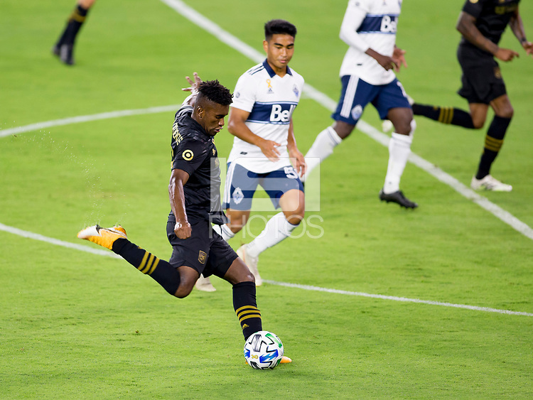 LOS ANGELES, CA - SEPTEMBER 23: Jose Cifuentes #11 of LAFC takes a shot during a game between Vancouver Whitecaps and Los Angeles FC at Banc of California Stadium on September 23, 2020 in Los Angeles, California.