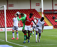 10th October 2020; Bescot Stadium, Walsall, West Midlands, England; English Football League Two, Walsall FC versus Colchester United; Elijah Debayo of Walsall attacks the goal from a cross taken by keeper Gerken of Colchester