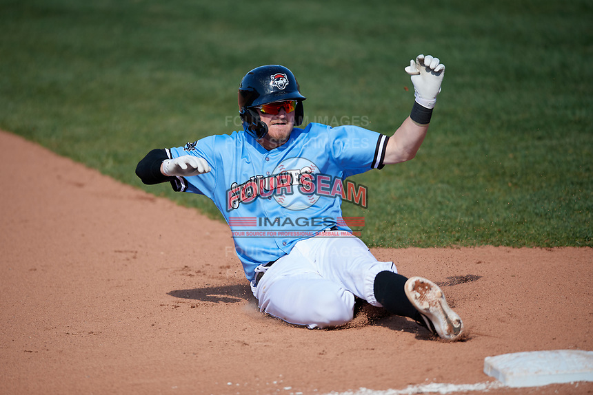 Erie SeaWolves Kody Eaves (22) slides into third base after hitting a triple during an Eastern League game against the Akron RubberDucks on June 2, 2019 at UPMC Park in Erie, Pennsylvania.  Erie defeated Akron 8-5 in eleven innings in the second game of a doubleheader.  (Mike Janes/Four Seam Images)