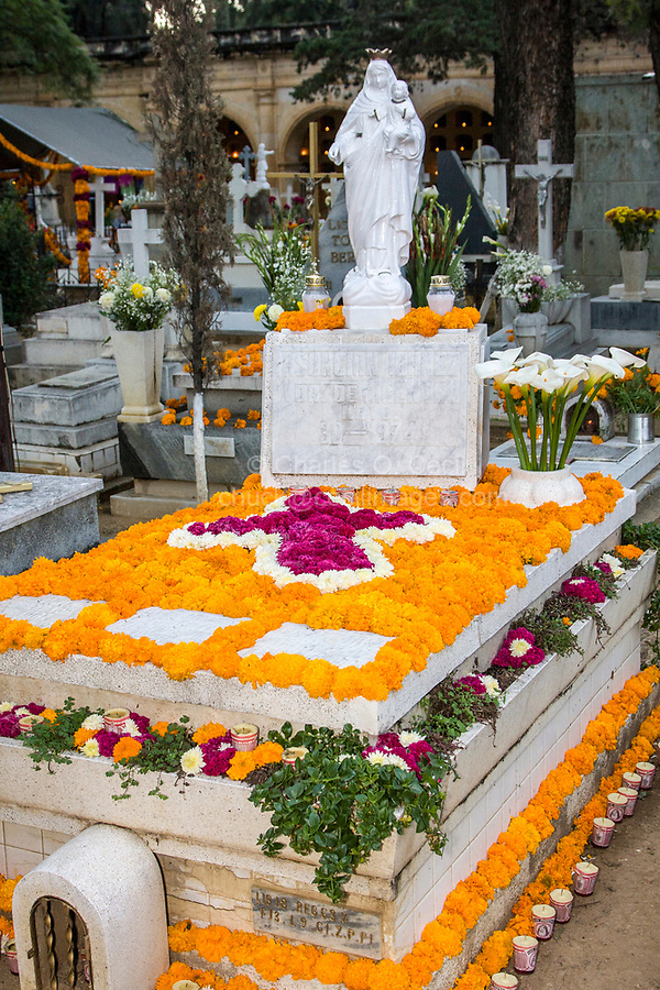 Oaxaca, Mexico, North America.  Day of the Dead Celebrations.  Marigolds and Cockscomb Decorate a Grave in Memory of the Dead.  San Miguel Cemetery, Oaxaca.