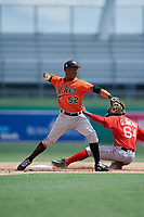 Baltimore Orioles shortstop Jean Carmona (52) throws to first base on an attempted double play as Gilberto Jimenez (64) slides into second base during a Florida Instructional League game against the Boston Red Sox on September 21, 2018 at JetBlue Park in Fort Myers, Florida.  (Mike Janes/Four Seam Images)