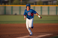 AZL Cubs 2 second baseman Reivaj Garcia (24) hustles to third base during an Arizona League game against the AZL Reds at Sloan Park on June 18, 2018 in Mesa, Arizona. AZL Cubs 2 defeated the AZL Reds 4-3. (Zachary Lucy/Four Seam Images)