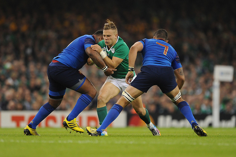 Ian Madigan of Ireland runs into Mathieu Bastareaud of France as Damien Chouly of France supports during Match 39 of the Rugby World Cup 2015 between France and Ireland - 11/10/2015 - Millennium Stadium, Cardiff<br /> Mandatory Credit: Rob Munro/Stewart Communications