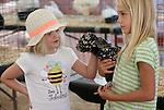 Sarah Gray, 6, left, checks out Sarah Scott's Polish banta Fluffy at the NV150 Fair at Fuji Park, in Carson City, Nev., on Friday, Aug. 1, 2014.<br /> Photo by Cathleen Allison