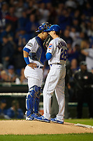 Chicago Cubs pitcher Kyle Hendricks (28) talks with catcher Willson Contreras (40) in the first inning during Game 3 of the Major League Baseball World Series against the Cleveland Indians on October 28, 2016 at Wrigley Field in Chicago, Illinois.  (Mike Janes/Four Seam Images)
