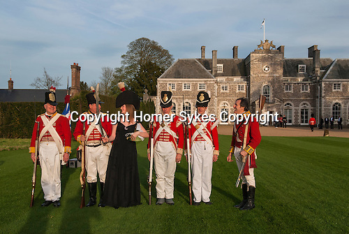 Country mansion British society wealth landed gentry private home Farleigh House, Farleigh Wallop, Hampshire. Lady Clementine Wallop with pretend weekend soldiers. UK 2008,