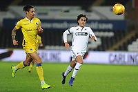 Daniel Leadbitter of Bristol Rovers vies for possession with Yan Dhanda of Swansea City U21 during the Checkatrade Trophy match between Swansea City U21 and Bristol Rovers at the Liberty Stadium in Swansea, Wales, UK. Wednesday 05 December 2018