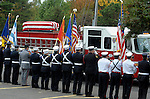 The casket arrives on the hose bed of Hartford Engine 16, during the funeral for Hartford firefighter Kevin Bell, Monday, Oct. 13, 2014, at First Cathedral Church in Bloomfield. Bell was killed at a house fire in last week Hartford. (Jim Michaud / Journal Inquirer)