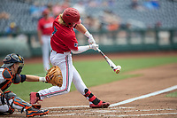 Louisville Cardinals outfielder Lucas Dunn (7) swings the bat during Game 7 of the NCAA College World Series against the Auburn Tigers on June 18, 2019 at TD Ameritrade Park in Omaha, Nebraska. Louisville defeated Auburn 5-3. (Andrew Woolley/Four Seam Images)