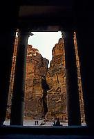 Columns of El Khazneh Treasury entrance and view of the Siq Canyon, Petra, Jordan.