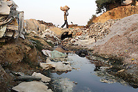 A man carries pieces of chromium at a waste dumping ground on the outskirts of Kanpur. The city is notorious for having some of the country's worst water pollution which is created by the local leathery tannery industry. Waste water laced with toxic chemicals, such as chromium, is discharged in local waterways and agricultural land which is used many residents who live in the nearby area. An array of health problems now afflict locals who use the water including cancers, mental health problems, child development issues and skin diseases.