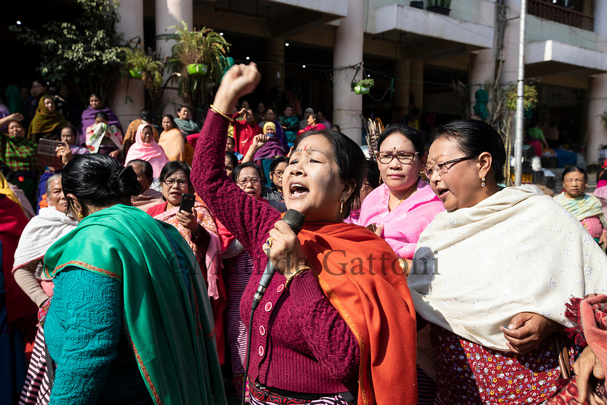 India - Manipur - Imphal - A vendor of the Ima Market shouts during a political rally.