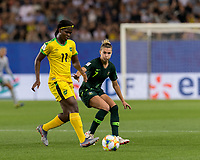 GRENOBLE, FRANCE - JUNE 18: Khadija Shaw #11 of the Jamaican National Team dribbles  as Chloe Logarzo #6 of the Australian National Team defends during a game between Jamaica and Australia at Stade des Alpes on June 18, 2019 in Grenoble, France.
