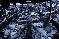 wreckages of the police trucks  torched by the rioters during the   protest against new draconian law to ban the right to  protest across the country.  Kiev. Ukraine