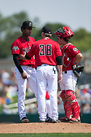 Billings Mustangs pitching coach Seth Etherton (38) has a meeting on the mound with starting pitcher Jhon De Jesus (28) and catcher Mark Kolozsvary (4) during the game against the Missoula Osprey at Dehler Park on August 20, 2017 in Billings, Montana.  The Osprey defeated the Mustangs 6-4.  (Brian Westerholt/Four Seam Images)