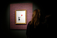 Exhibition of the artist Bansky, titled A visual Protest, at Chiostro del Bramante in Rome. In the picture the painting Girl with the balloon<br /> Rome (Italy), September 10th 2020<br /> Photo Samantha Zucchi Insidefoto