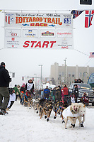 Matt Giblin and team leave the ceremonial start line at 4th Avenue and D street in downtown Anchorage during the 2013 Iditarod race. Photo by Jim R. Kohl/IditarodPhotos.com