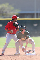 Billy McKinney #20 of the Oakland Athletics steals second base during a Minor League Spring Training Game against the Los Angeles Angels at the Los Angeles Angels Spring Training Complex on March 17, 2014 in Tempe, Arizona. (Larry Goren/Four Seam Images)