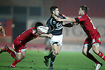 Frank Murphy looks for support out wide as Gareth Maule and Liam Williams close in..RaboDirect Pro12.Scarlets v Connacht.02.03.12.©STEVE POPE